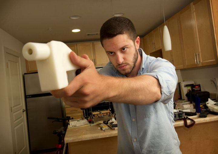Cody Wilson shows off the first completely 3D-printed handgun, The Liberator, at his home in Austin, Texas, on May 10, 2013.