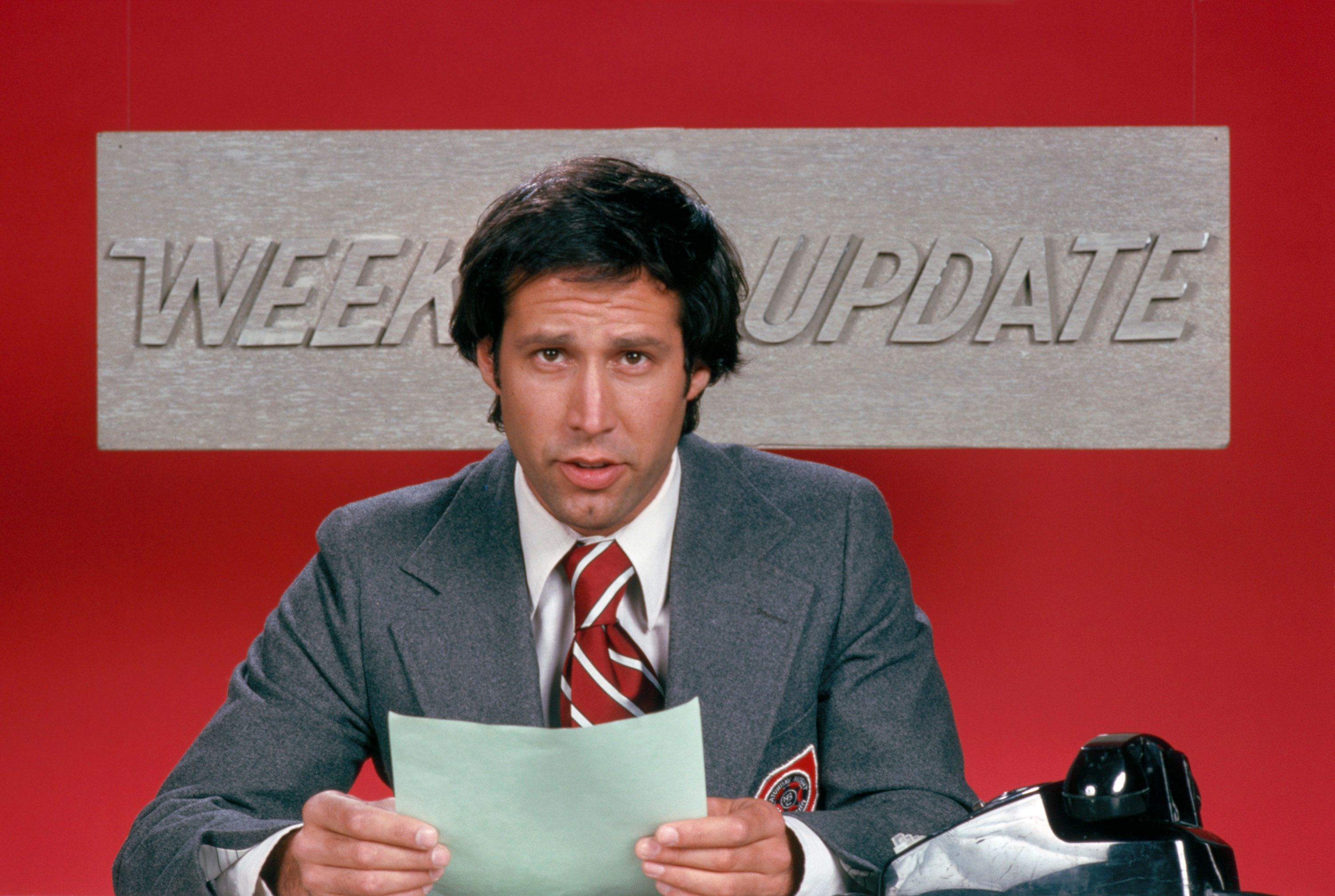 """Chevy Chase hosts the """"Weekend Update"""" segment on """"SNL"""" years ago. Chase expressed in a recent interview that he doesn't find the show funny anymore."""