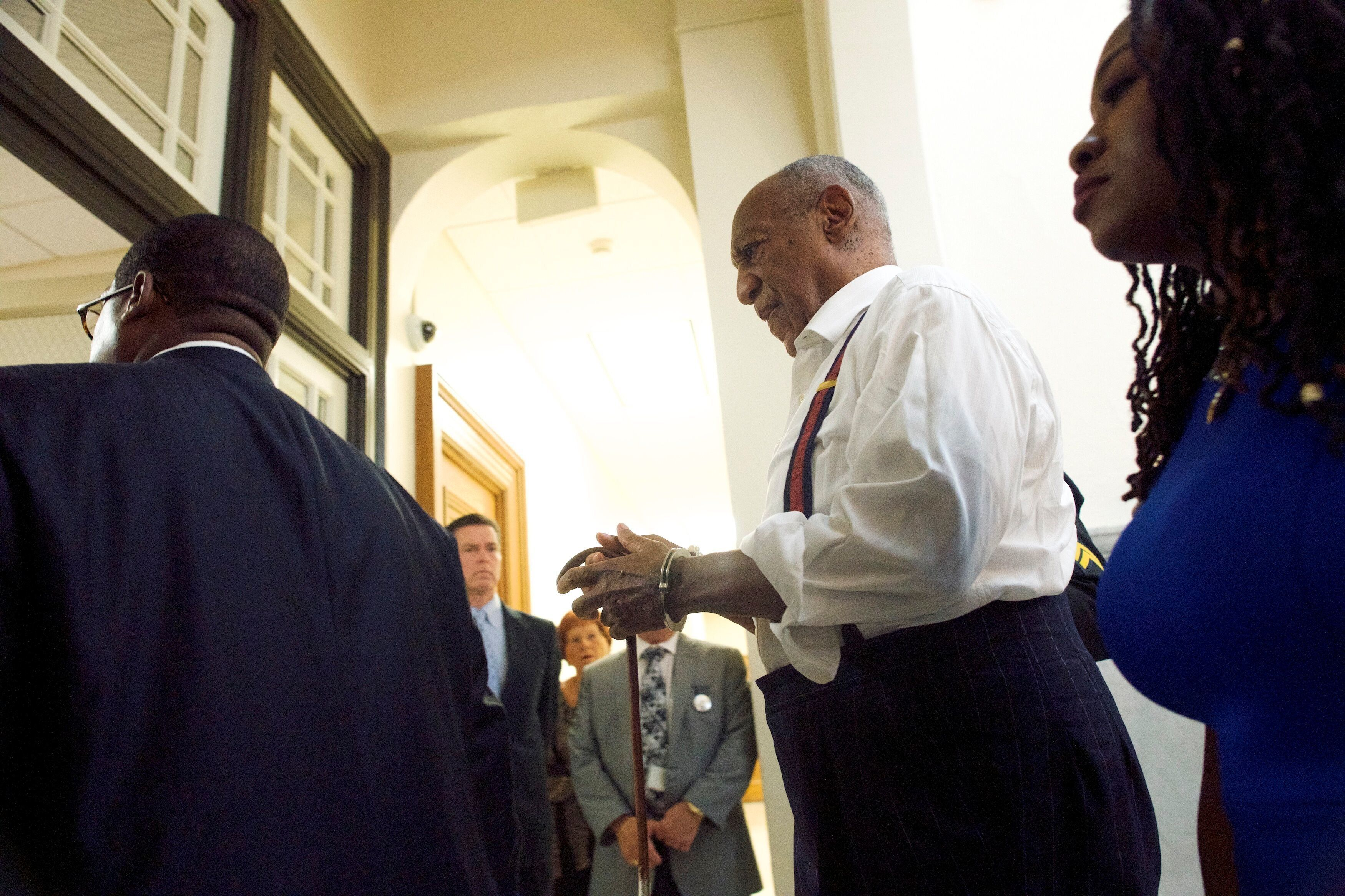 Cosby being taken into custody in handcuffs on Tuesday