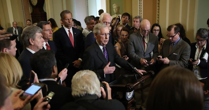 Senate Majority Leader Mitch McConnell (R-Ky.), center, tells the press Tuesday at the Capitol that he is confident Republica