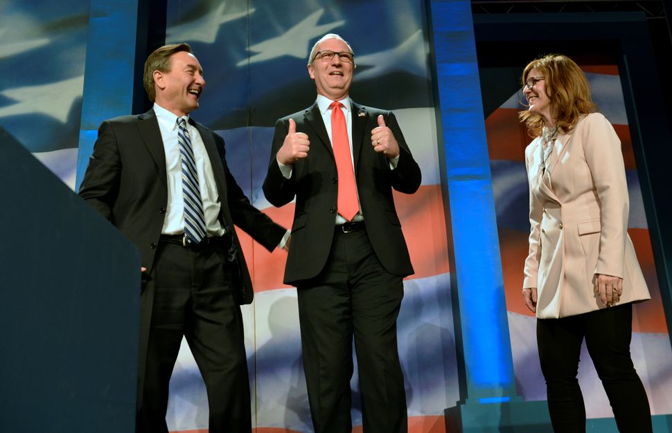 GOP strategists are certain Rep. Kevin Cramer (center, flanked by allies at a party gathering) will defeat Democratic Sen. He