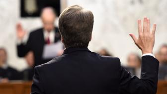Judge Brett Kavanaugh is sworn in by the Chairman of the US Senate Judiciary Committee Chuck Grassley (rear), during his US Senate Judiciary Committee confirmation hearing to be an Associate Justice on the US Supreme Court, on Capitol Hill in Washington, DC, September 4, 2018. - President Donald Trump's newest Supreme Court nominee Brett Kavanaugh is expected to face punishing questioning from Democrats this week over his endorsement of presidential immunity and his opposition to abortion. (Photo by Brendan SMIALOWSKI / AFP)        (Photo credit should read BRENDAN SMIALOWSKI/AFP/Getty Images)