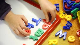 EMBARGOED TO 0001 WEDNESDAY JULY 18 File photo dated 08/02/12 of a child playing. Parents are now shelling out £133 a week per child on average for childcare during the school holidays, a report has found.