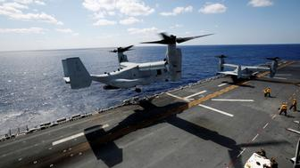 A U.S. Marine Corps MV-22 Osprey aircrafts take off from the USS Wasp (LHD 1) amphibious assault carrier during their operation in the waters off Japan's southernmost island of Okinawa March 23, 2018. REUTERS/Issei Kato