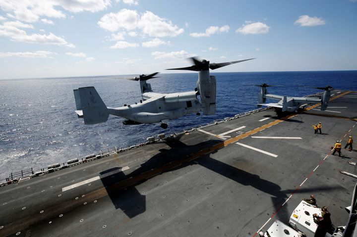 A U.S. Marine Corps MV-22 Osprey aircrafts take off from the USS Wasp amphibious assault carrier during an operation in the w