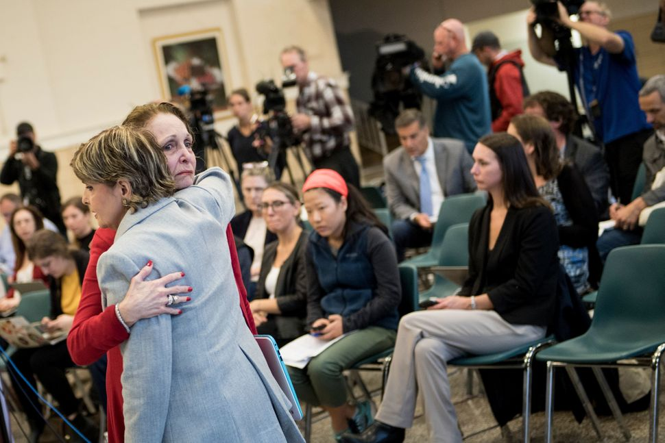 Cosby accuser Sunni Welles hugs attorney Gloria Allred before reading her victim impact statement on Sept. 25, 2018, in Norri