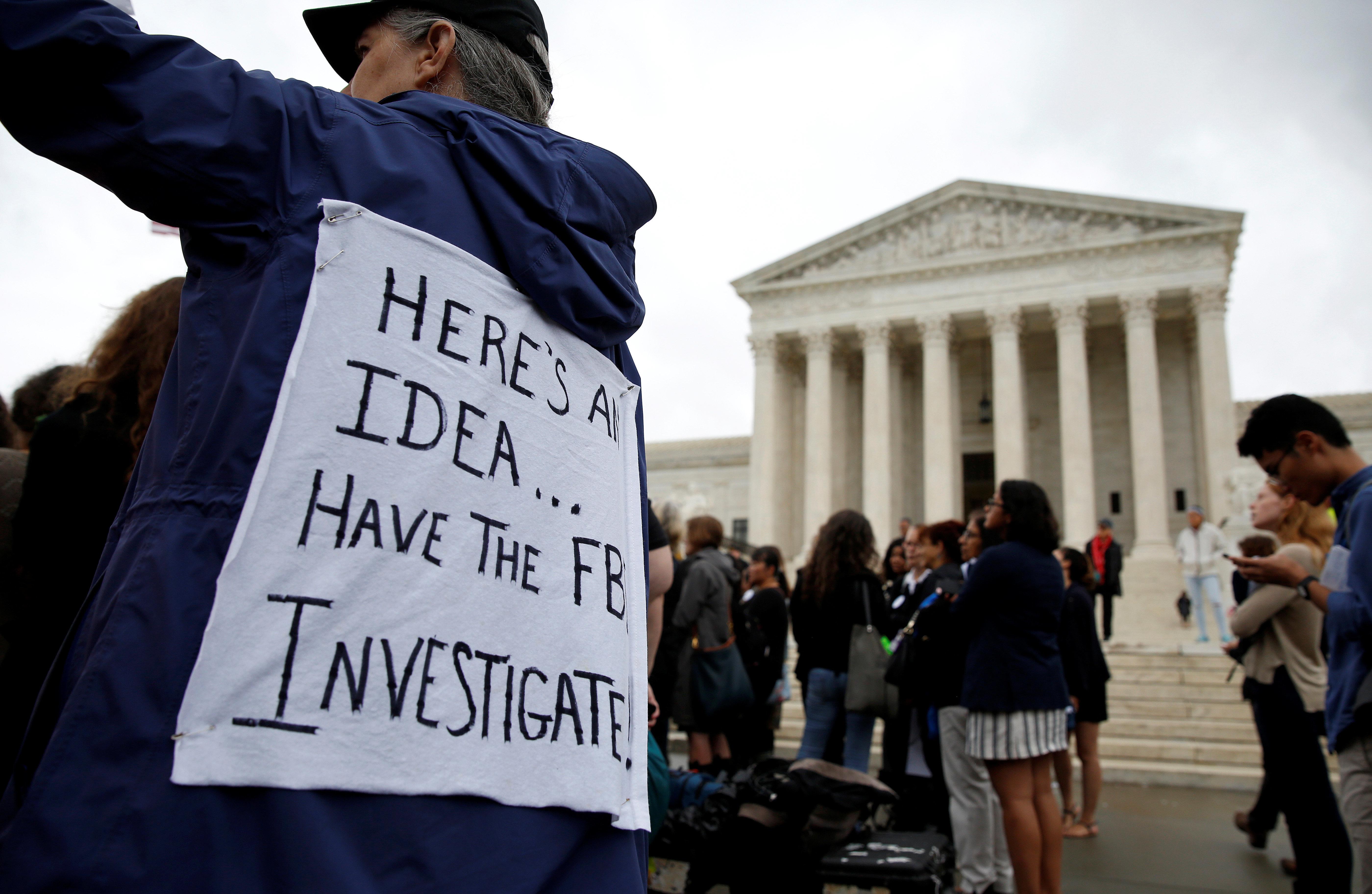 Demonstrators protest against U.S. Supreme Court nominee Brett Kavanaugh in front of the Supreme Court in Washington, U.S., September 24, 2018.      REUTERS/Joshua Roberts