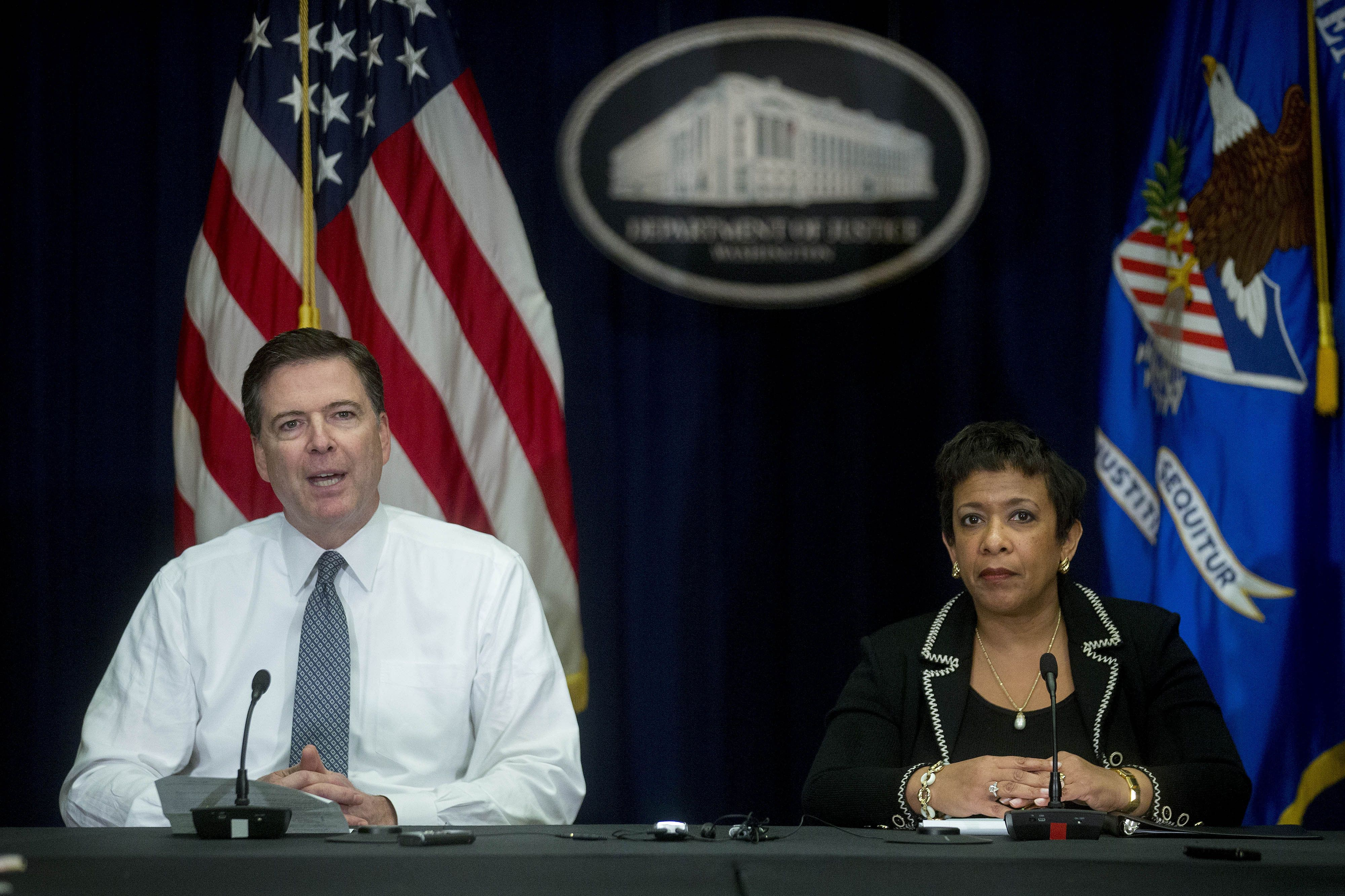 James Comey, director of the Federal Bureau of Investigation (FBI), left, speaks during a news conference with Loretta Lynch, U.S. attorney general, at the Department of Justice in Washington, D.C., U.S., on Thursday, Nov. 19, 2015. Comey told reporters that the greater threat in the U.S. is troubled people inspired by Islamic State attacks, rather than the coordinated attacks as in Paris and that Americans shouldnt let fear rule their lives. Photographer: Andrew Harrer/Bloomberg via Getty Images