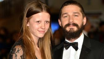 LONDON, ENGLAND - OCTOBER 19:  Mia Goth and Shia LeBeouf attend the closing night European Premiere gala red carpet arrivals for 'Fury' during the 58th BFI London Film Festival at Odeon Leicester Square on October 19, 2014 in London, England.  (Photo by Anthony Harvey/Getty Images for BFI)