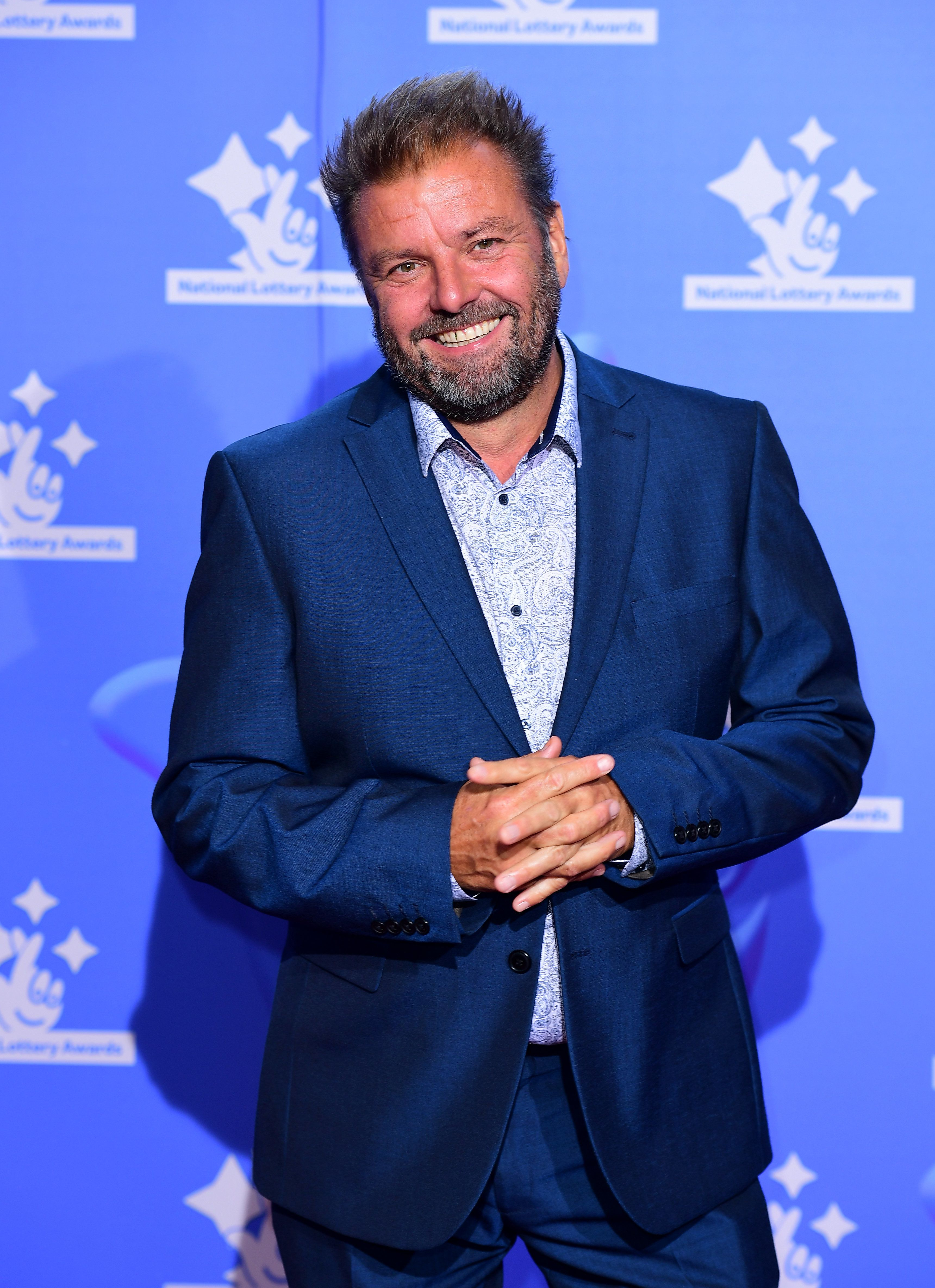 Here's What Martin Roberts Thinks Of The Incredibly Literal 'Homes Under The Hammer'