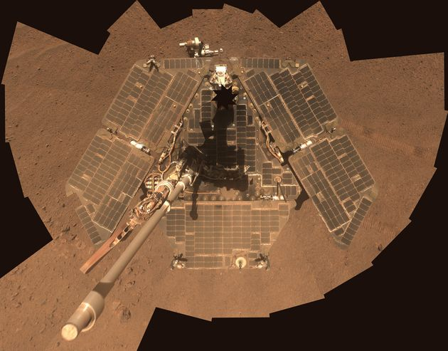 NASA's Mars Exploration Rover Opportunity, seen in 2014, has gone into hibernation mode after a global...