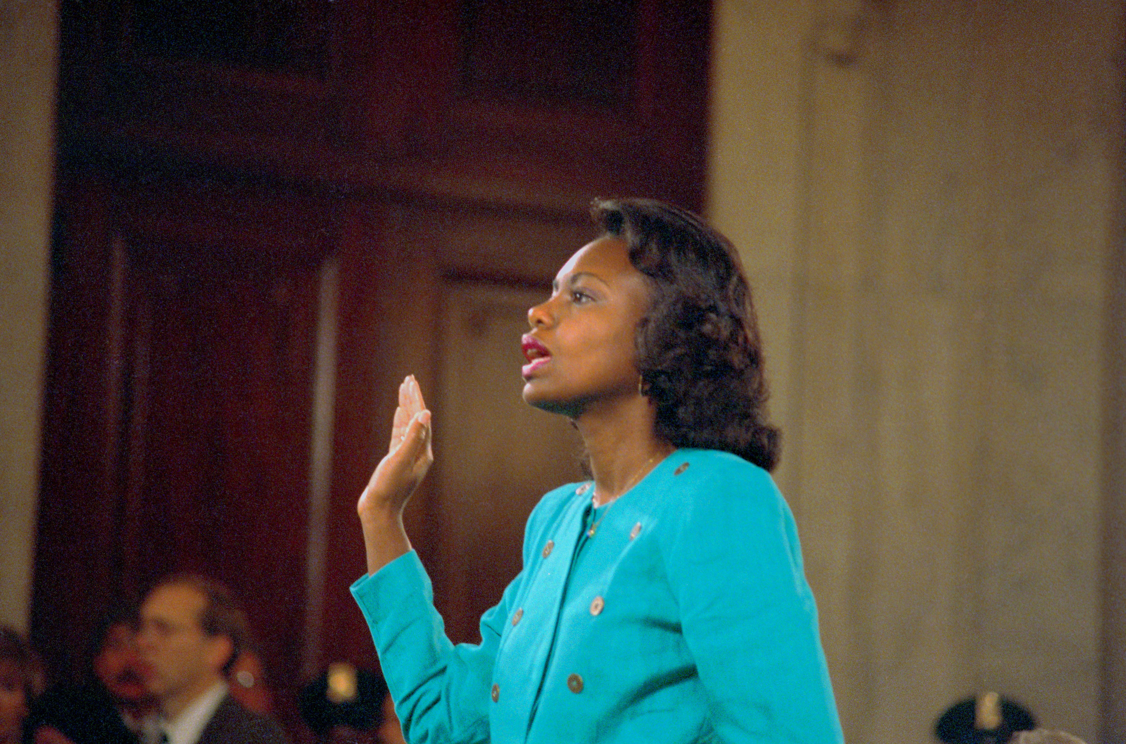 Anita Hill is sworn in before testifying at the Senate Judiciary Committee hearing on Clarence Thomas in 1991.