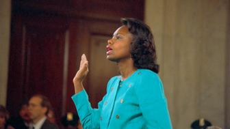 (Original Caption) Washington: Professor Anita Hill is sworn-in before testifying at the Senate Judiciary hearing on the Clarence Thomas Supreme Court nomination. Miss Hill testified on her charges of alleged sexual harassment by Judge Thomas.