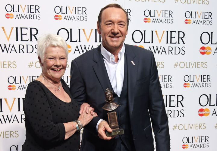Dame Judi Dench and Kevin Spacey, winner of the Special Award, pose in the winners room at The Olivier Awards on April 12, 20