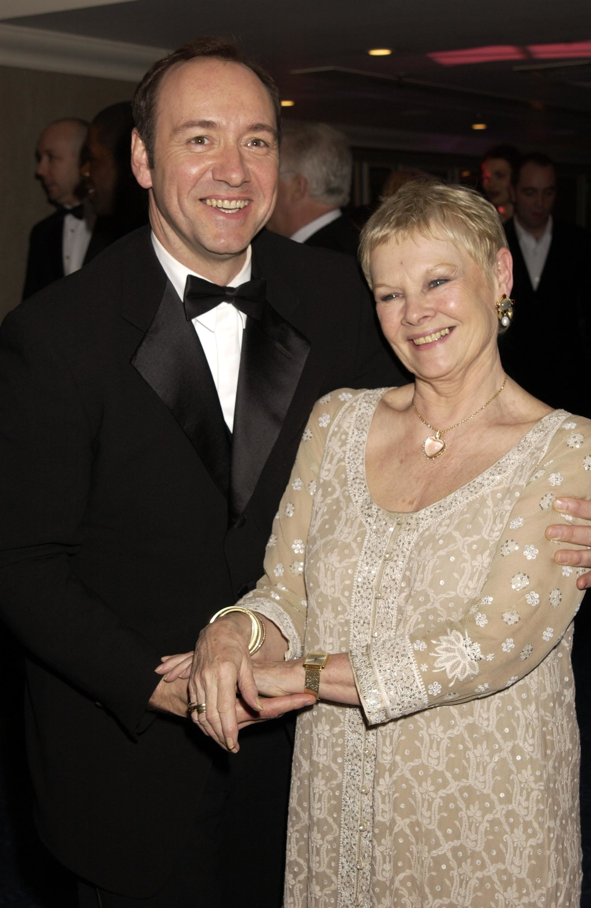 UNITED KINGDOM - FEBRUARY 24:  Kevin Spacey & Judi Dench, The Orange British Academy Film Awards (bafta) 2002 After Party, At The Odeon, Leicester Square, London  (Photo by Dave Benett/Getty Images)