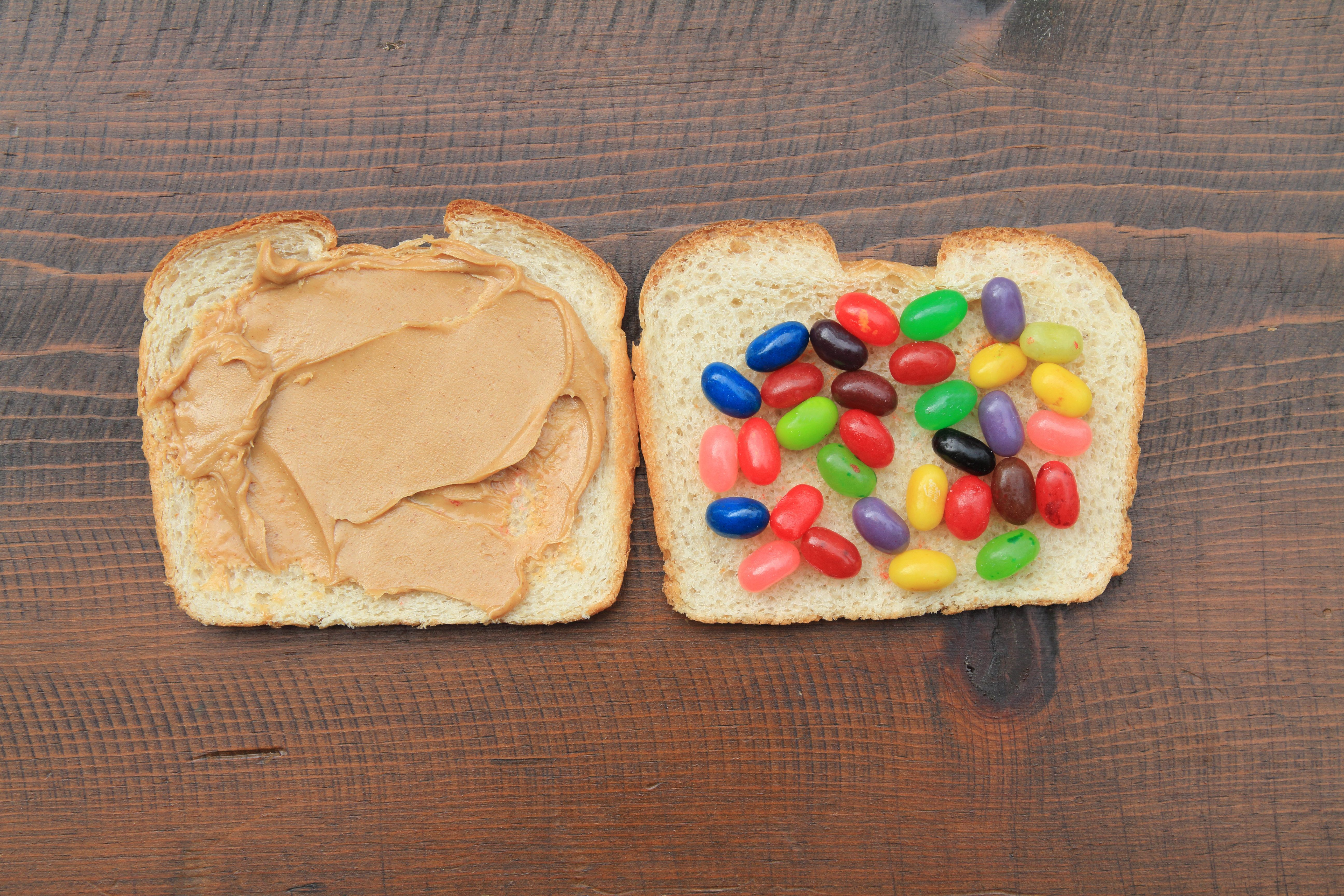 Peanut butter and jelly bean sandwich. Junk food concept. Unusual food combination. Humor.
