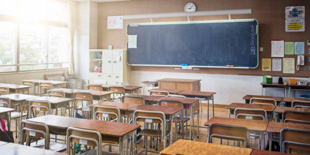 Sun shining on an empty Japanese classroom.