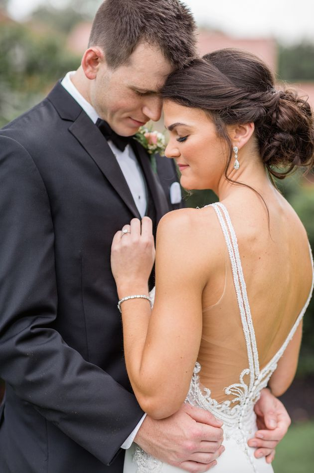 Liz Mylin, who is wearing a Martina Liana gown in this photo, married Karl Rice on Aug. 18 in York,