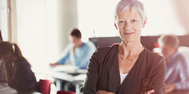 Portrait of confident senior woman in adult education classroom