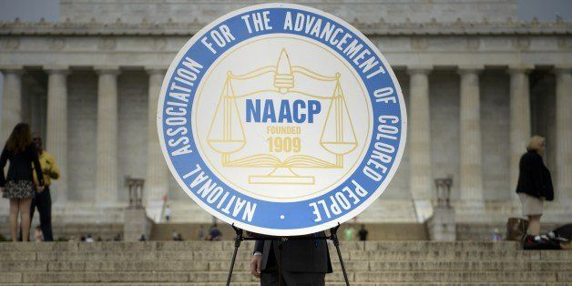 A sign with the logo of the National Association for the Advancement of Colored People(NAACP), is seen during a rally at the