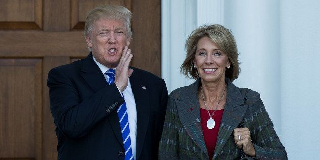 BEDMINSTER TOWNSHIP, NJ - NOVEMBER 19: (L to R) president-elect Donald Trump and Betsy DeVos  pose for a photo after their me