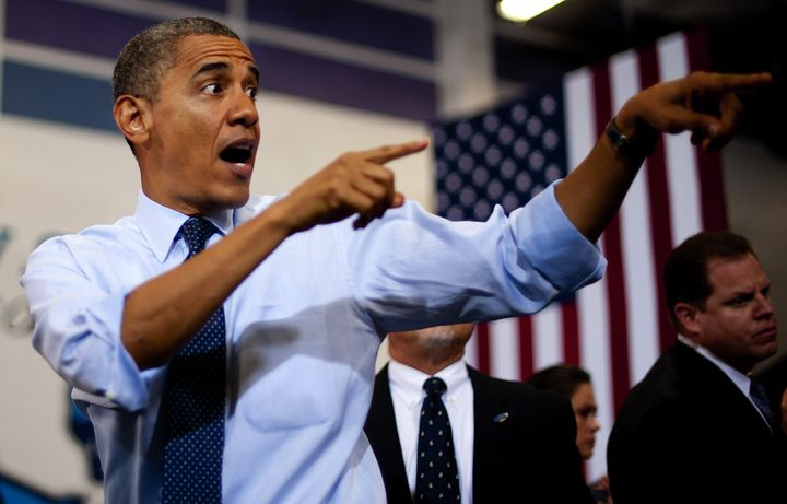 US President Barack Obama gestures as he arrives to deliver remarks during a campaign event at Canyon Springs High School in
