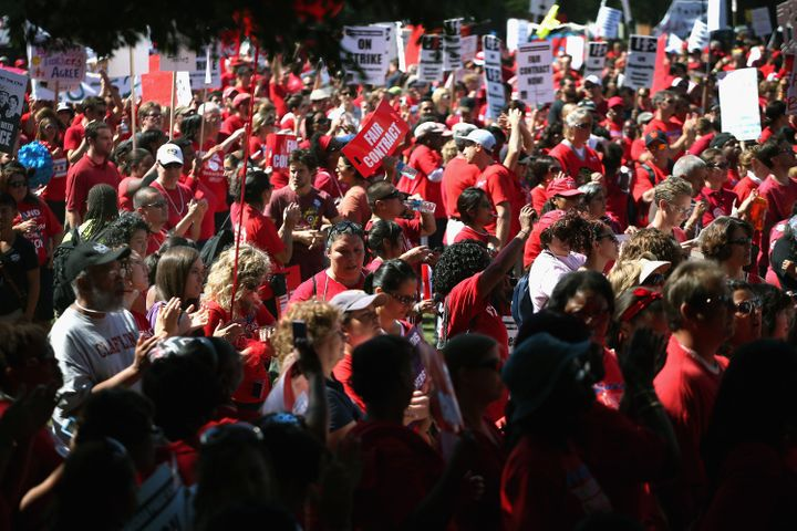 CHICAGO, IL - SEPTEMBER 15:  Striking Chicago teachers and their supporters attend a rally at Union Park September 15, 2012 i