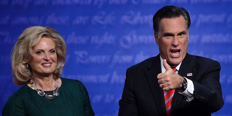 Republican presidential candidate Mitt Romney gestures beside his wife Ann following  the third and final presidential debate
