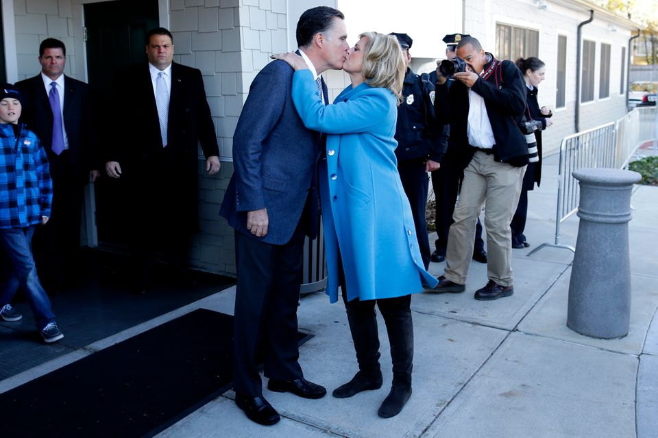 Republican presidential candidate, former Massachusetts Gov. Mitt Romney kisses wife Ann Romney after they voted in Belmont,