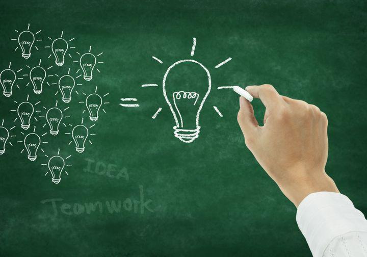 hand writing light bulb on...