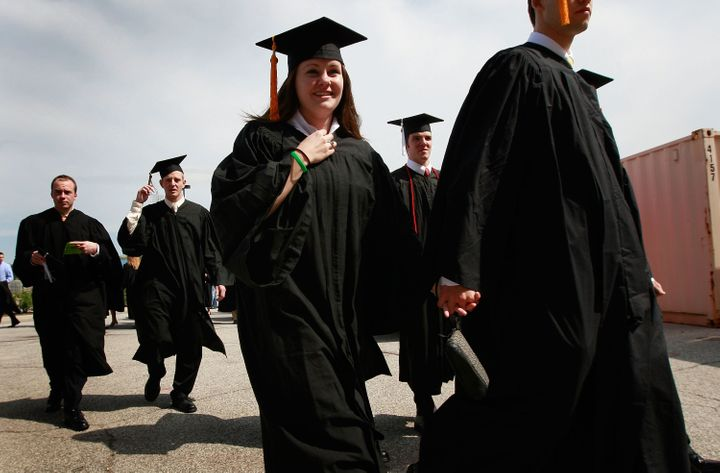 SOUTH BEND, IN - MAY 16: Notre Dame University graduates arrive for a mass at the Edmund Joyce Arena on May 16, 2009 in South Bend, Indiana. Pro-life activists from around the country have been gathering in South Bend to protest the university's decision to invite President Barack Obama, who supports abortion rights, to deliver the commencement address Sunday and to award him an honorary degree. (Photo by Scott Olson/Getty Images)