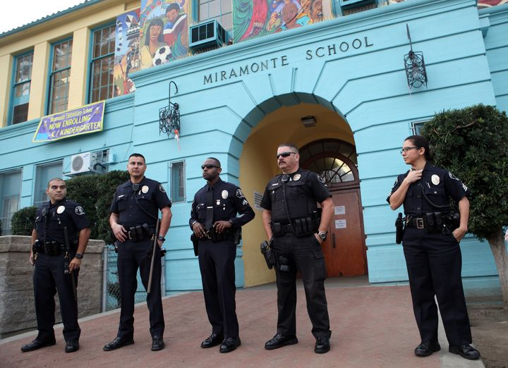 Police stand outside Miramonte Elementary School in Los Angeles, California February 6, 2012.   Miramonte teacher Mark Berndt
