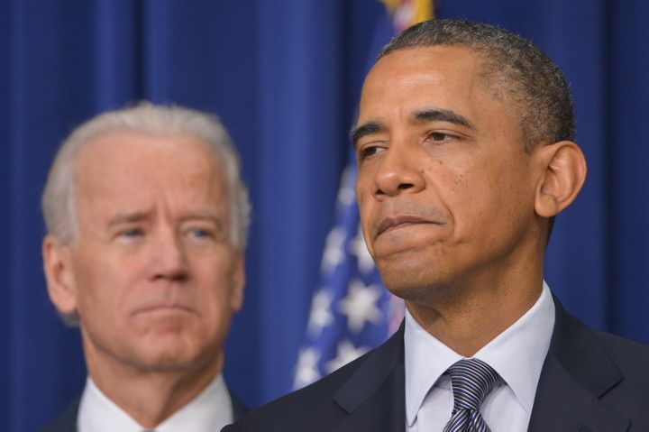 US President Barack Obama speaks on proposals to reduce gun violence as Vice President Joe Biden watches on January 16, 2013