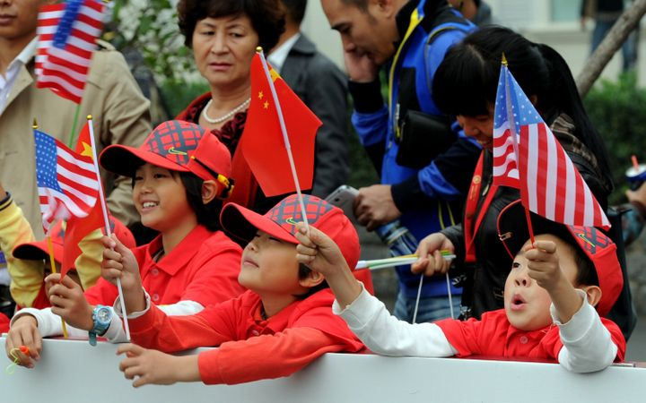 TO GO WITH US-vote-China,FOCUS by Sebastien Blanc Chinese children wave their national flag together with the US flags as the