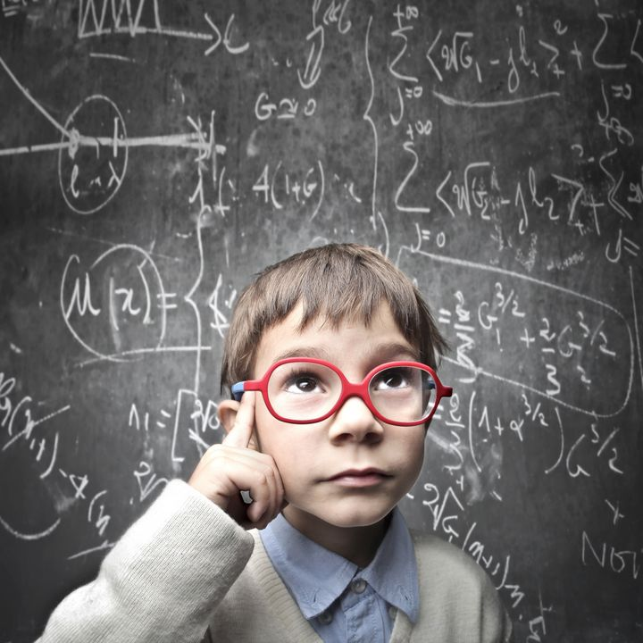 Thinking child with a blackboard in the background