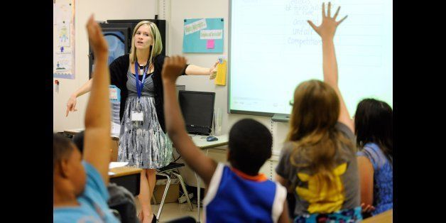 In this Oct. 1, 2013, file photo, Amy Lawson, a fifth-grade teacher at Silver Lake Elementary School in Middletown, Del., tea
