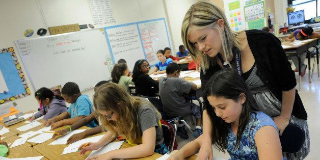 Amy Lawson, a fifth-grade teacher at Silver Lake Elementary School in Middletown, Del., helps student Melody Fritz with an En