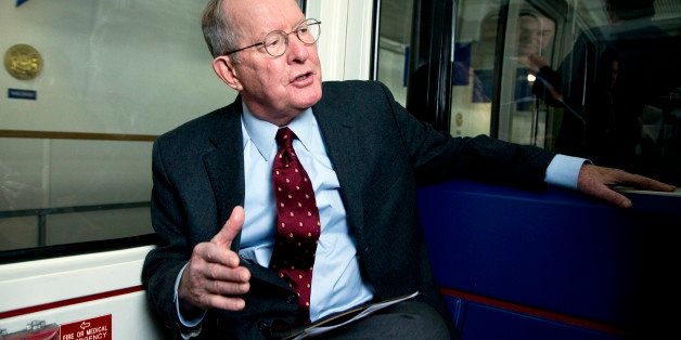 This Nov. 14, 2014, photo, shows Sen. Lamar Alexander, R-Tenn., speaking during an interview as he rides the subway from the