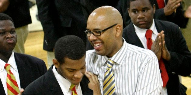 **ADVANCE FOR MONDAY JUNE 28** In this photo taken Tuesday, June 1, 2010 Urban Prep High School founder Tim King, right, embr