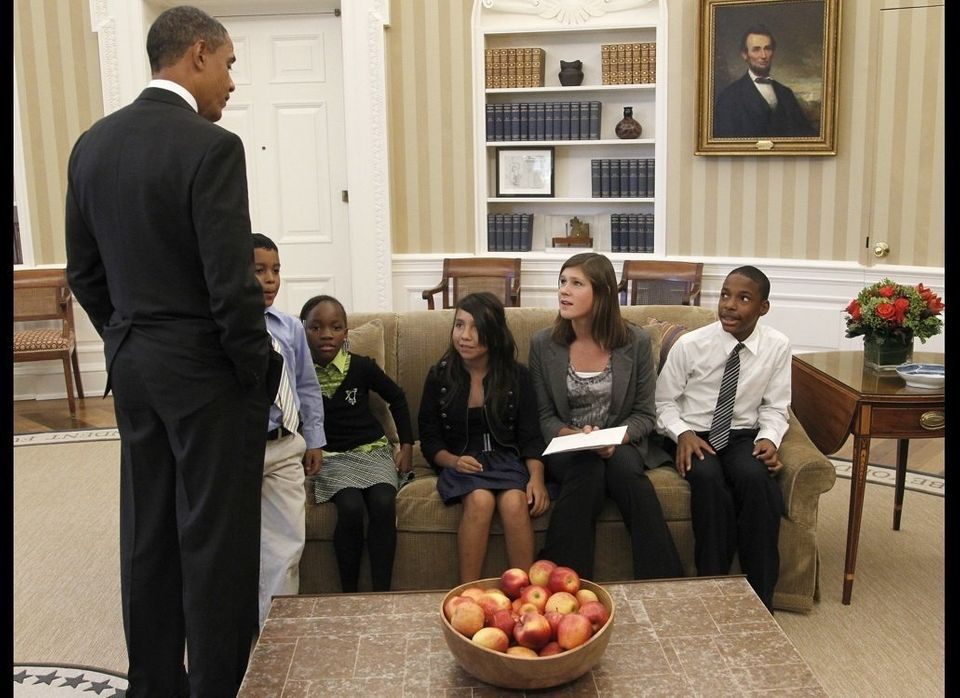 "President Barack Obama greets the five children who were featured in the documentary ""Waiting for Superman"" in the Oval Offic"