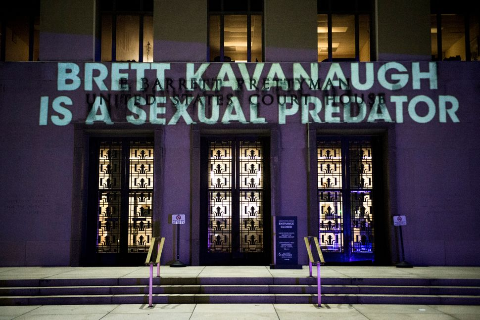 The political protest group UltraViolet projected anti-Brett Kavanaugh messages on the United States Court of Appeals on Tues