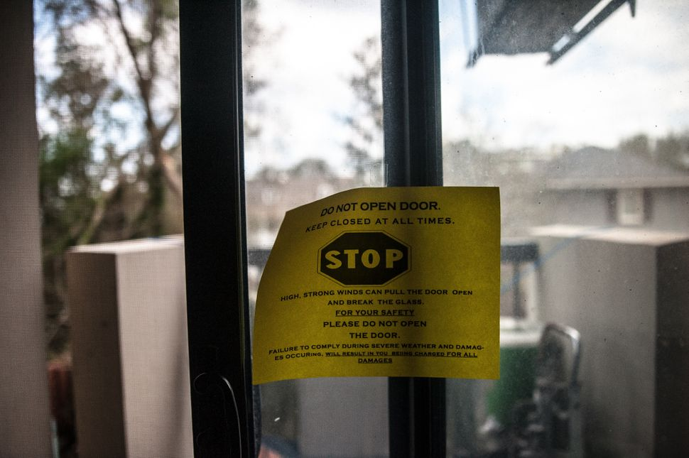 The Wilmington Housing Authority placed warning signs on residents' glass doors before Hurricane Florence struck.