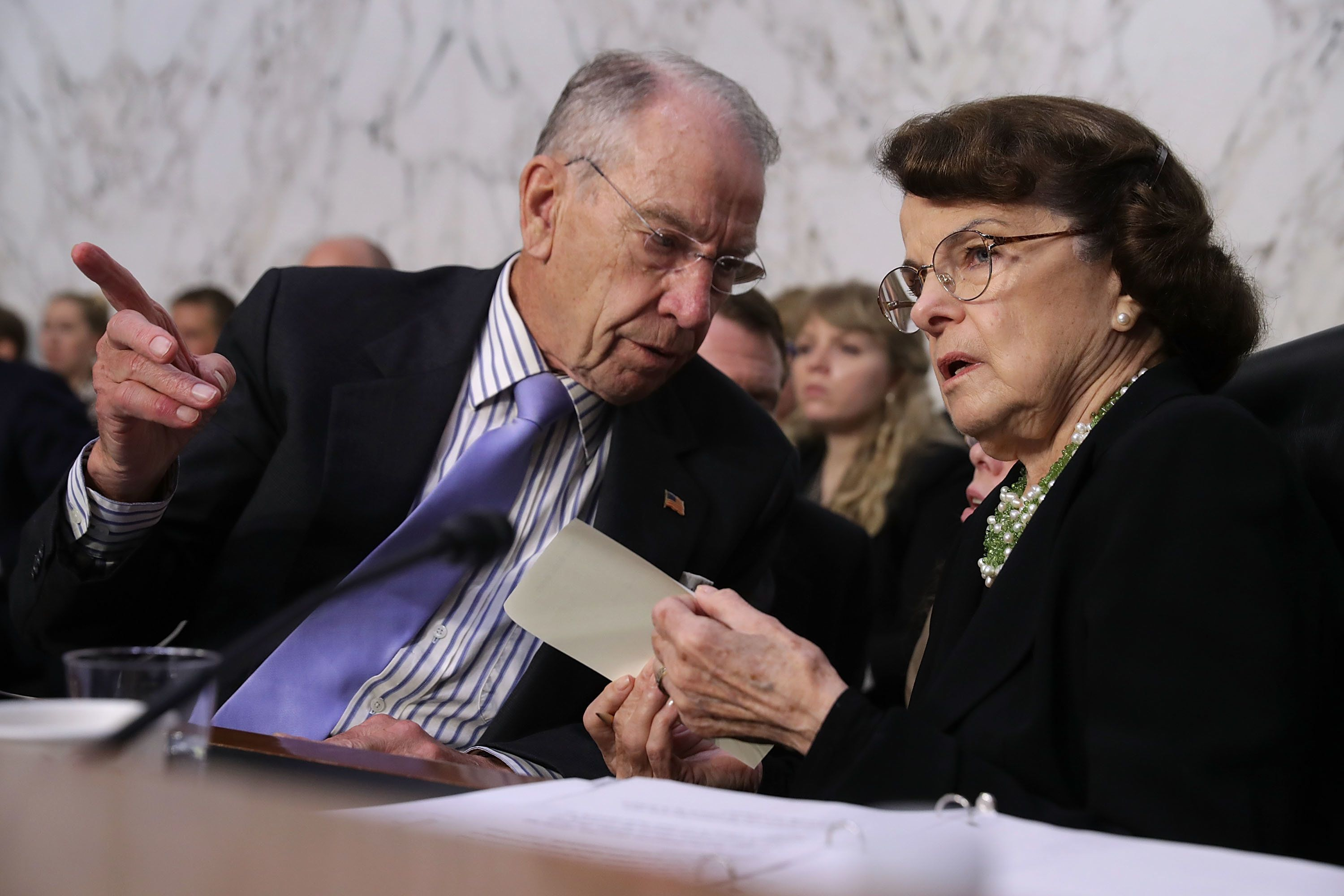 WASHINGTON, DC - SEPTEMBER 06:  Senate Judiciary Committee Chairman Charles Grassley (R-IA) (L) talks with ranking member Sen. Dianne Feinstein (D-CA) during the third day of Supreme Court nominee Judge Brett Kavanaugh's confirmation hearing in the Hart Senate Office Building on Capitol Hill September 6, 2018 in Washington, DC. Kavanaugh was nominated by President Donald Trump to fill the vacancy on the court left by retiring Associate Justice Anthony Kennedy.  (Photo by Chip Somodevilla/Getty Images)