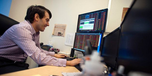 Martin Shkreli, chief investment officer of MSMB Capital Management, works on a computer in his office in New York, U.S., on