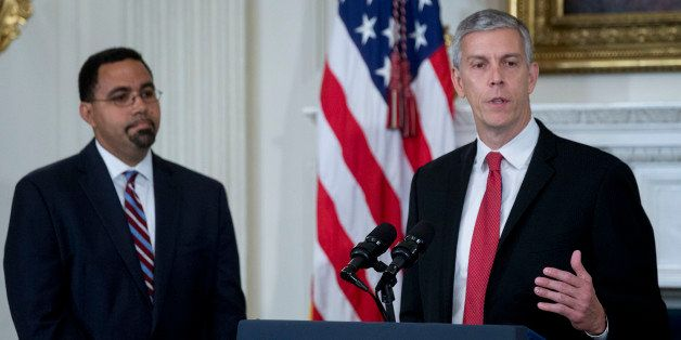 Arne Duncan, U.S. education secretary, right, speaks during a news conference with John King Jr., senior advisor at the U.S.