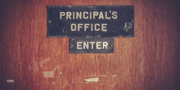 Retro Filtered Image Of A Grungy Principal's Office Door At A Public School In The USA