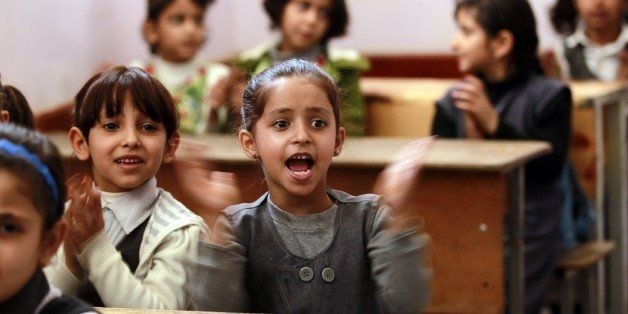 Yemeni girls clap their hands on their fist day of school at a public institution in the Yemeni capital Sanaa on November 1,