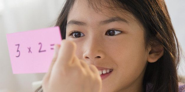 Vietnamese girl studying math with flash cards