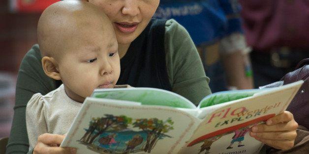 WASHINGTON, DC - JANUARY 29:  Five-year-old Ayana Ruslan and her mother Altinay Kuchukeeva read a book by photographer and ar