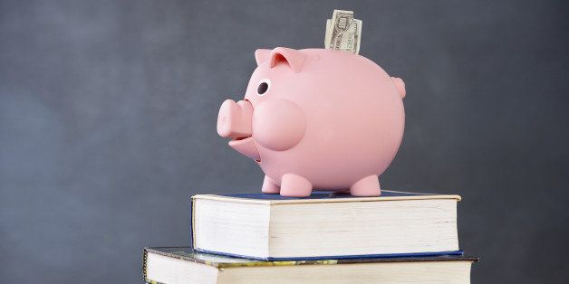Piggy bank on stack of books